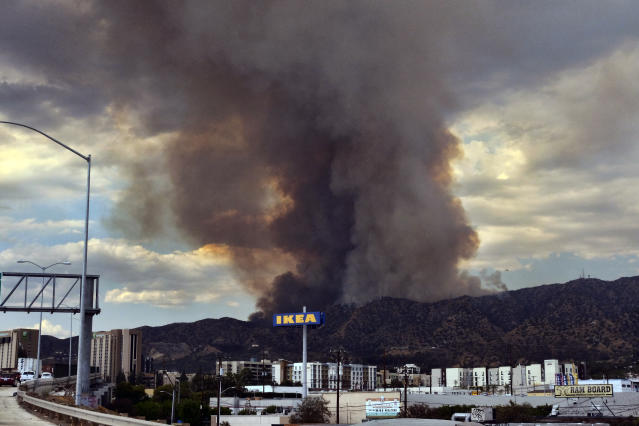 <p>Heavy black smoke rises as a wildfire burns dozens of acres in the Tujunga area of Los Angeles, seen from nearby Burbank, Calif., Friday afternoon, Sept. 1, 2017. (Photo: Richard Vogel/AP) </p>