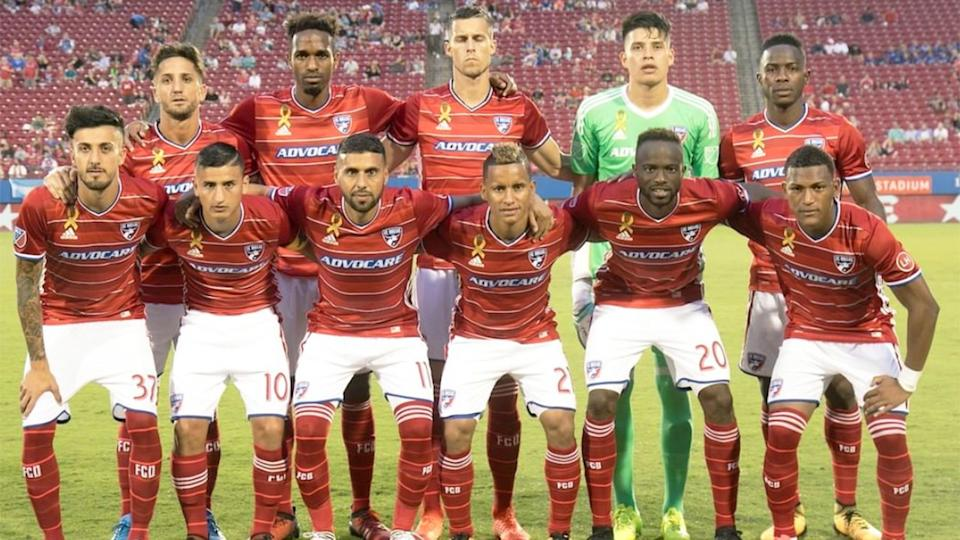 Pictured here, members of the FC Dallas team pose for a photo before a match.