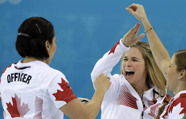 Canada's skip Jennifer Jones, center, celebrates with teammates Jill Officer, left, and Kaitlyn Lawes after winning the women's curling gold medal game against Sweden at the 2014 Winter Olympics, Thursday, Feb. 20, 2014, in Sochi, Russia. (AP Photo/Wong Maye-E)