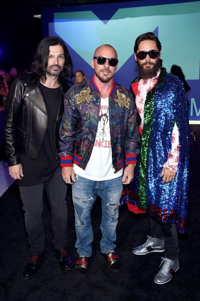 <p>Jared Leto wore a sequin Gucci cape with his Thirty Seconds to Mars bandmates. (Photo: Getty Images) </p>