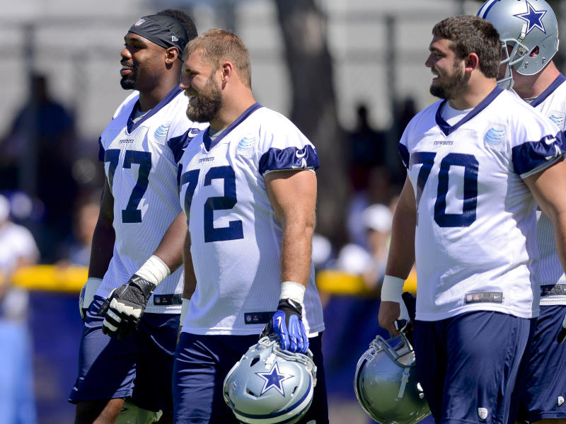 Cowboys build model by paying line, Pats win another way