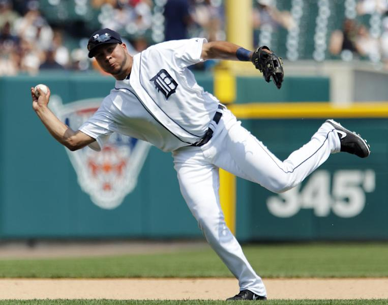 Detroit Tigers shortstop Jhonny Peralta throws out Boston Red Sox's Shane Victorino at first base on a ground ball in the sixth inning of a baseball game on Sunday, June 23, 2013, in Detroit. (AP Photo/Duane Burleson)