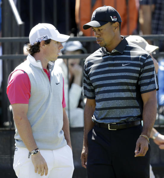 Tiger Woods, right, talks to Rory McIlroy, of Northern Ireland, at the 10th tee during the first round play at the Cadillac Golf Championship, in Doral, Fla., Thursday March 7, 2013. (AP Photo/Wilfredo Lee)