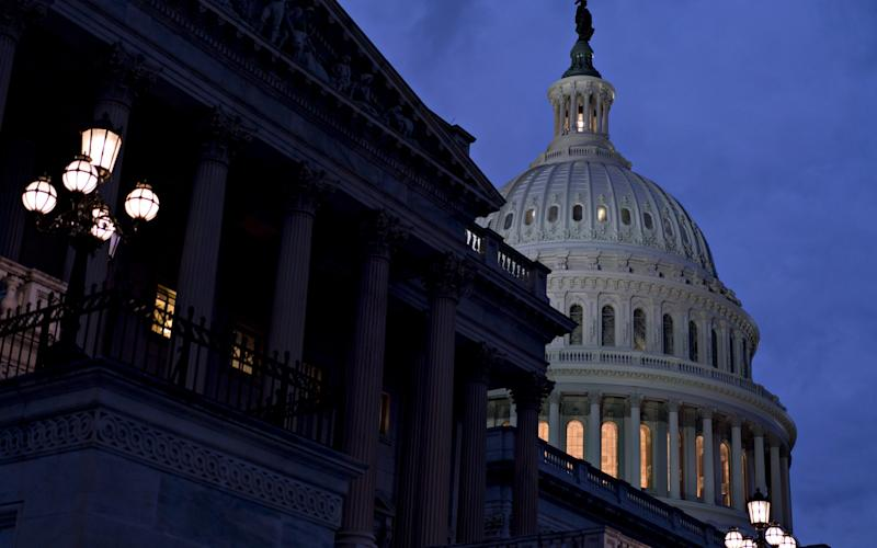 The House and Senate convened on Sunday with a federal government shutdown in its second day - Bloomberg