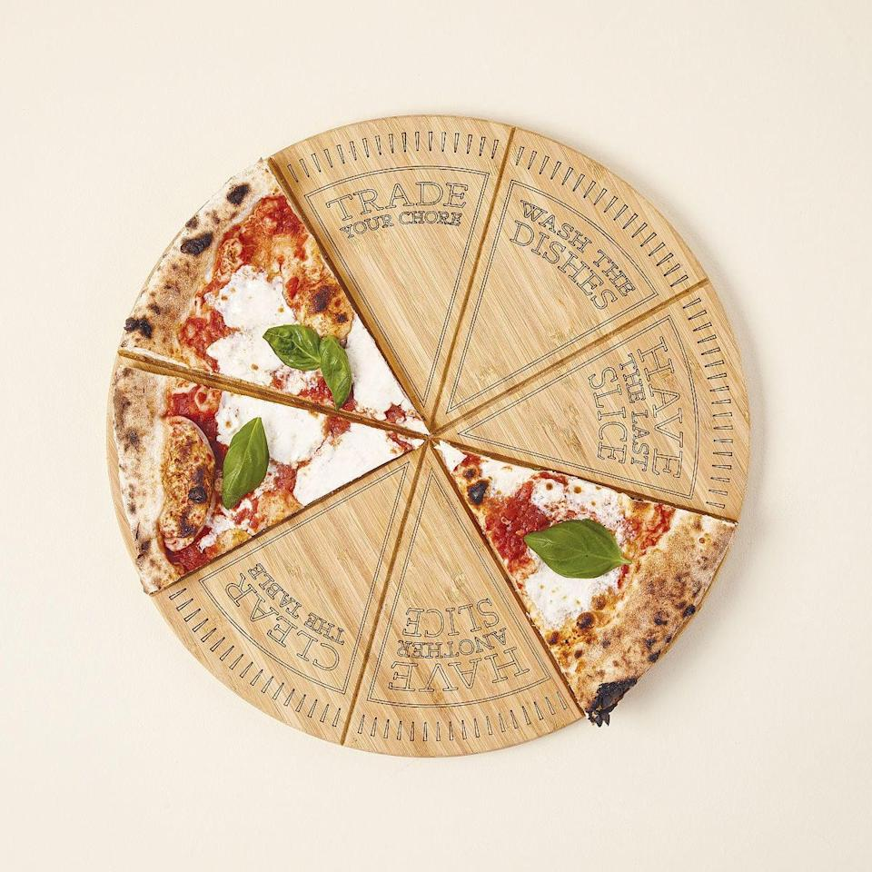 <p>If you love having pizza nights at home, this fun <span>Pizza Roulette Cut &amp; Serve Board</span> ($50) will help you out in the kitchen. This board let you choose which chore each person has to complete, including washing dishes, clearing the table, or even fun ones like trading your chore or getting to have another slice. </p>