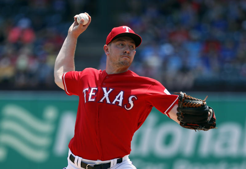 Texas Rangers' Adrian Sampson throws to the Seattle Mariners in the fourth inning of a baseball game in Arlington, Texas, Wednesday, May 22, 2019. (AP Photo/Tony Gutierrez)