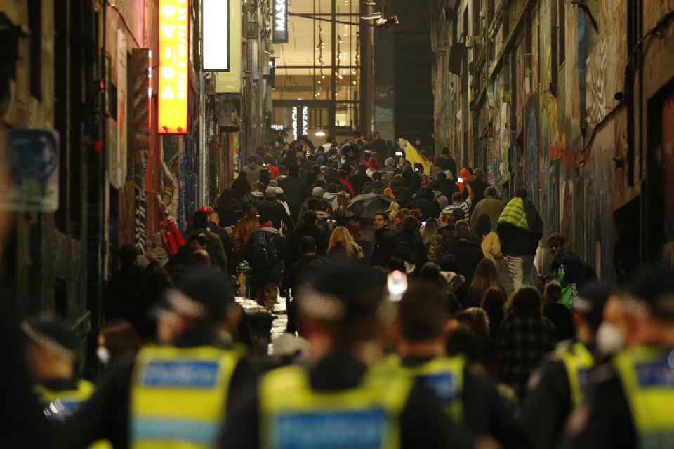 Protesters march up Melbourne's famous Hosier Lane. Source: AAP