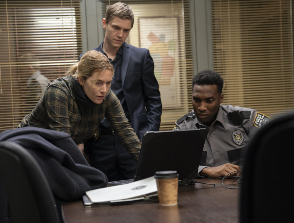 Kate Winslet in character as Mare Sheehan with Evan Peters as Detective Colin Zabel on the set of the Binge TV series Mare of Easttown