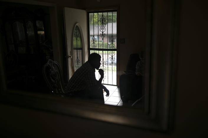 La Jarvis D. Love is seen reflected by a mirror at his home in Senatobia, Miss., Sunday, June 9, 2019. Love says he regrets agreeing to keep his alleged sexual abuse secret. (AP Photo/Wong Maye-E)