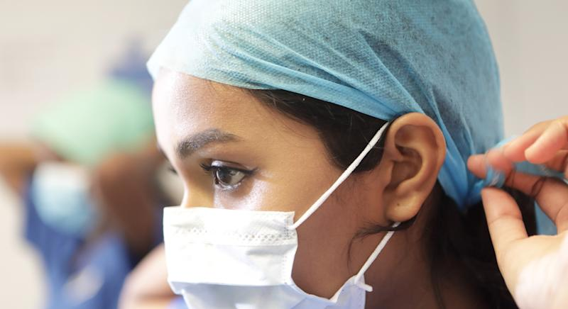 A string of global fashion brands have pivoted to manufacture masks and gowns for medical staff. (Getty Images)