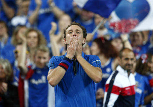 France's Lucas Pouille reacts after defeating Spain's Roberto Bautista Agut during the Davis Cup semifinals France against Spain, Friday, Sept. 14, 2018, in Lille, northern France. (AP Photo/Michel Spingler)