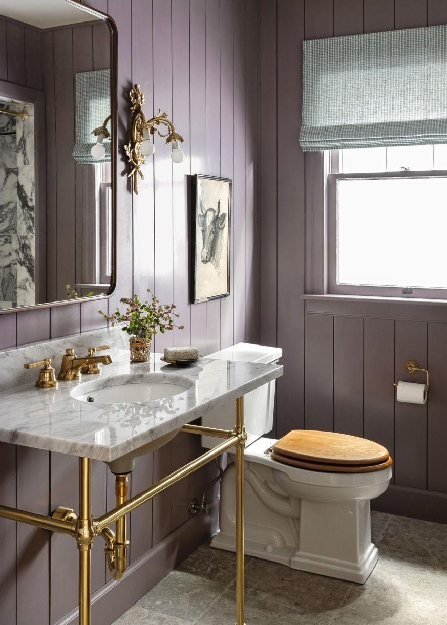 """<p>Add some life to wood-paneled walls with a coat of <a href=""""https://go.redirectingat.com?id=74968X1596630&url=https%3A%2F%2Fwww.farrow-ball.com%2Fen-us%2Fpaint-colours%2Fbrassica&sref=https%3A%2F%2Fwww.popularmechanics.com%2Fhome%2Fg37190959%2Fpaint-colors-small-rooms%2F"""" rel=""""nofollow noopener"""" target=""""_blank"""" data-ylk=""""slk:Brassica by Farrow & Ball"""" class=""""link rapid-noclick-resp"""">Brassica by Farrow & Ball</a>. This muted purple shade with brown undertones ensures that your powder room feels sophisticated, not stuffy or hemmed in. </p>"""