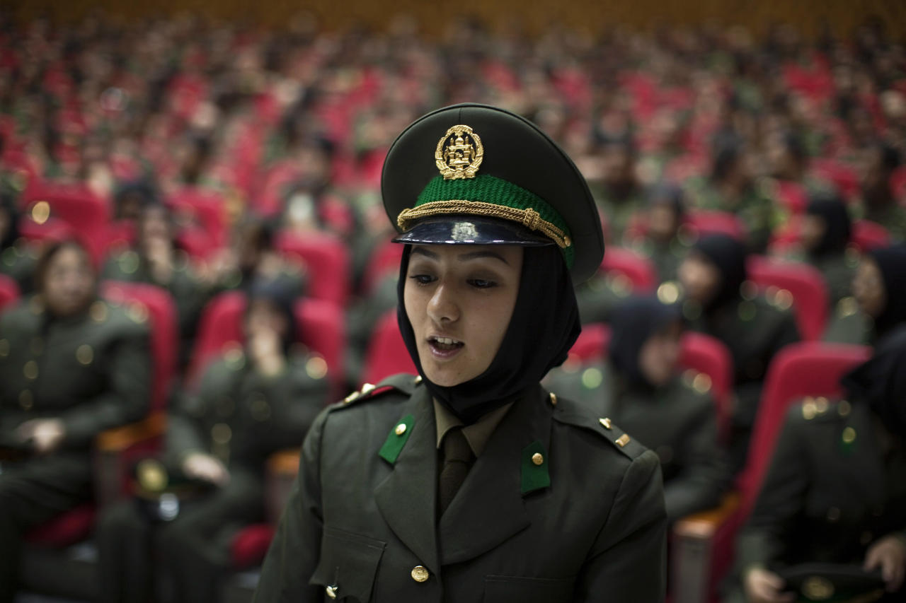 A newly graduated soldier from the Afghan National Army (ANA) attends a graduation ceremony in Kabul September 23, 2010. Afghanistan's army got its first female officers in decades on Thursday when 29 women graduated in a class of new recruits. REUTERS/Ahmad Masood  (AFGHANISTAN - Tags: MILITARY POLITICS)