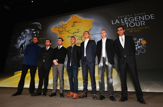 PARIS, FRANCE - OCTOBER 24: (l to r) Bradley Wiggins, Cadel Evans, Mark Cavendish, Philippe Gilbert, Tejay van Garderen, Chris Froome and Alberto Contador pose during the 2013 Tour de France Route Presentation at the Palais des Congres de Paris on October 24, 2012 in Paris, France. (Photo by Bryn Lennon/Getty Images)