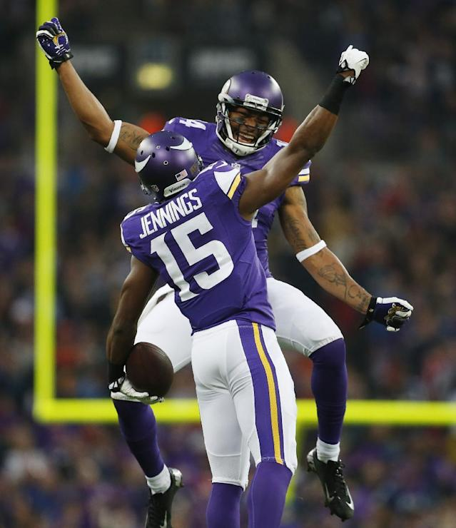 Minnesota Vikings wide receiver Joe Webb celebrates with Vikings wide receiver Greg Jennings (15) after Jennings' 70-yard touchdown pass from quarterback Matt Cassel during their NFL football game against the Pittsburgh Steelers at Wembley Stadium, London, Sunday,Sept. 29, 2013. (AP Photo/Matt Dunham)