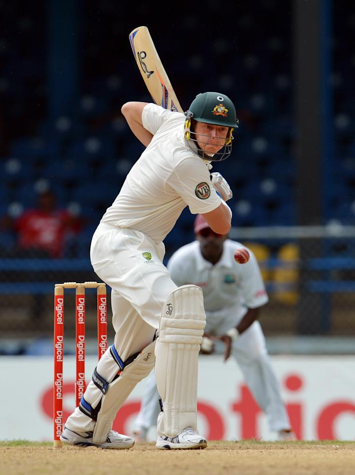 Australian batsman James Pattinson plays a shot during the second day of the second-of-three Test matches between Australia and West Indies April 16, 2012 at Queen's Park Oval in Port of Spain.    AFP PHOTO/Stan HONDA (Photo credit should read STAN HONDA/AFP/Getty Images)