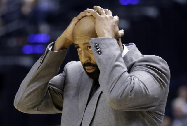 New York Knicks coach Mike Woodson reacts to a call in the first half of an NBA basketball game against the Indiana Pacers in Indianapolis, Thursday, Jan. 16, 2014. (AP Photo/Michael Conroy)