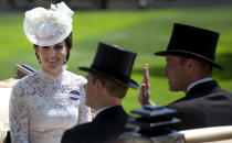 FILE - In this Tuesday, June 20, 2017 file photo, Britain's Kate, Duchess of Cambridge, left, smiles as she travels with Prince William, right, and Prince Edward in a open carriage to the parade ring on the first day of the Royal Ascot horse race meeting in Ascot, England. Prince Philip was the longest serving royal consort in British history. In Britain, the husband or wife of the monarch is known as consort, a position that carries immense prestige but has no constitutional role. The wife of King George VI, who outlived him by 50 years, was loved as the Queen Mother. Prince Charles' wife, Camilla, has worked to emerge from the shadow of his immensely popular first wife, Diana. (AP Photo/Alastair Grant, File)