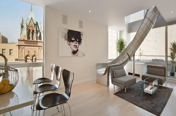 Luxury homes with bold features a slide a disco and more for Luxury home features