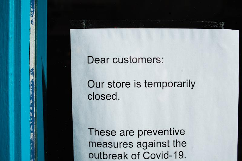 A notice informs customers of the temporary closure of a clothing store, shut over coronavirus concerns, on Carnaby Street in London, England, on March 21, 2020. Much of central London was virtually empty today, a day after British Prime Minister Boris Johnson ordered the closure of all pubs, bars, cafes and restaurants around the country. The move represents a toughening of measures to enforce the 'social distancing' that is being urged on citizens to reduce the growth of covid-19 coronavirus infections. Nightclubs, theatres, cinemas, gyms and leisure centres were also ordered closed. Some shops in the centre of capital remained open today, albeit mostly deserted of customers; many retailers however have temporarily closed their doors until the crisis abates. (Photo by David Cliff/NurPhoto via Getty Images)