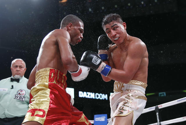 Sweat flies during a boxing bout between Thomas Dulorme, left, Jessie Vargas on Saturday, Oct. 6, 2018, in Chicago. (AP Photo/Kamil Krzaczynski)