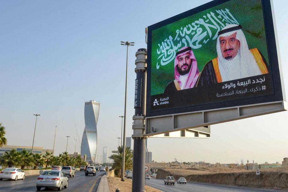 An electronic billboard bearing the portraits of the Saudi king, Salman bin Abdulaziz (right) and his son Mohammed bin Salman, ahead of a meeting of finance ministers and central bank governors of the G20 nations in the Saudi capital Riyadh.