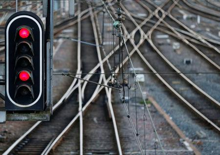 Rail tracks and red lights are seen at the French state-owned railway company SNCF's station in Bordeaux, France, March 13, 2018. REUTERS/Regis Duvignau