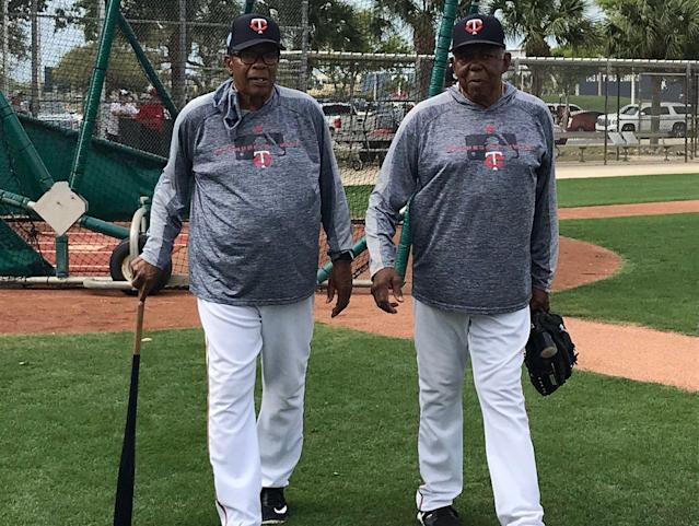 Rod Carew and Tony Oliva walk through camp as if in black-and-white. (Tim Brown/Yahoo Sports)