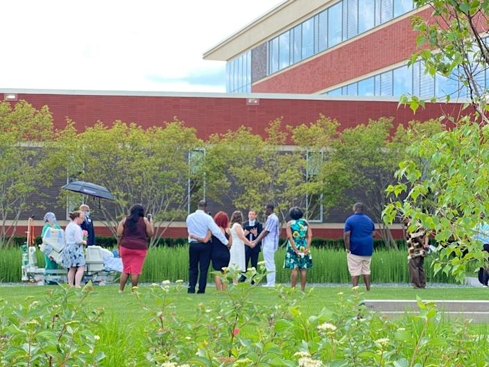 A small wedding was held in the courtyard at Lake Forest Hospital on July 5 to allow a hospice patient to witness her daughter's marriage. (Courtesy Lake Forest Hospital)