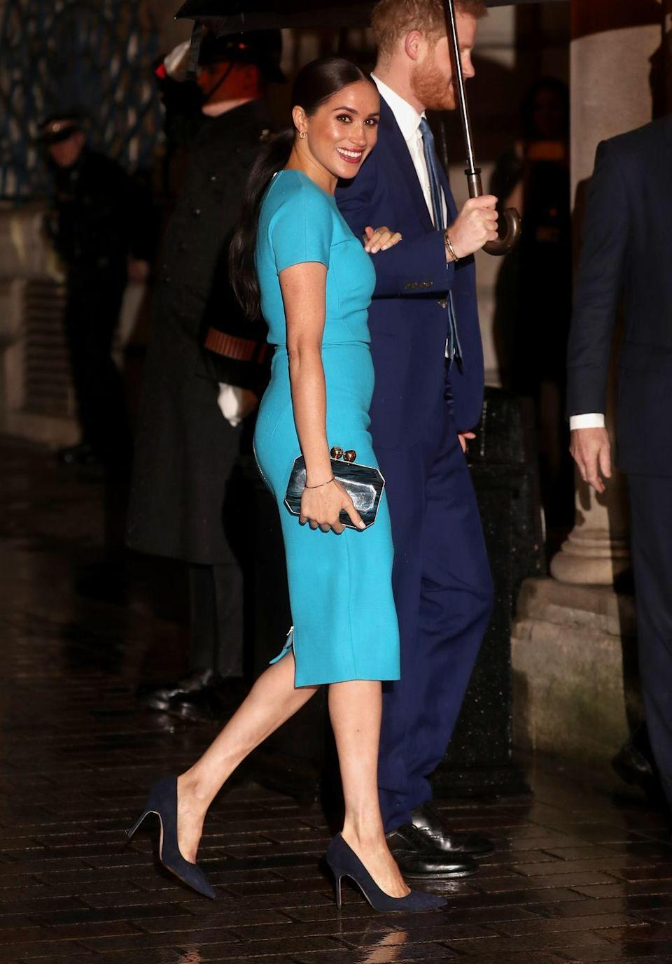 "<p>For one of her final appearances as a working royal, Meghan wore a turquoise <a href=""https://www.townandcountrymag.com/society/tradition/a31247693/meghan-markle-blue-dress-smile-endeavour-fund-awards-photos/"" rel=""nofollow noopener"" target=""_blank"" data-ylk=""slk:Victoria Beckham dress"" class=""link rapid-noclick-resp"">Victoria Beckham dress</a>, black pumps, and a Stella McCartney clutch. The royal couple attended the <a href=""https://www.townandcountrymag.com/society/tradition/g31137927/meghan-markle-prince-harry-endeavour-fund-2020-photos/"" rel=""nofollow noopener"" target=""_blank"" data-ylk=""slk:Endeavour Fund Awards"" class=""link rapid-noclick-resp"">Endeavour Fund Awards</a>, an annual ceremony that honors wounded servicemen and women who have used sport or adventurous challenges to aid in their recovery. </p>"
