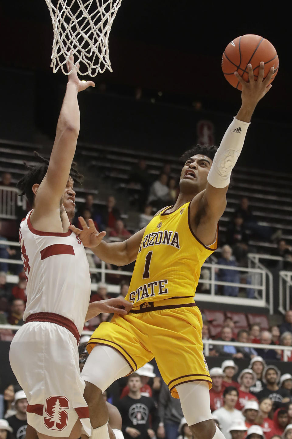 Arizona State guard Remy Martin (1) shoots against Stanford forward Spencer Jones during the first half of an NCAA college basketball game in Stanford, Calif., Thursday, Feb. 13, 2020. (AP Photo/Jeff Chiu)