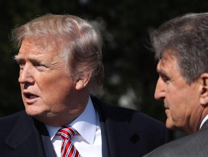 President Donald Trump talks with Sen. Joe Manchin during an event to honor the 2017 NCAA Football National Champion Alabama Crimson Tide at the White House on April 10, 2018.