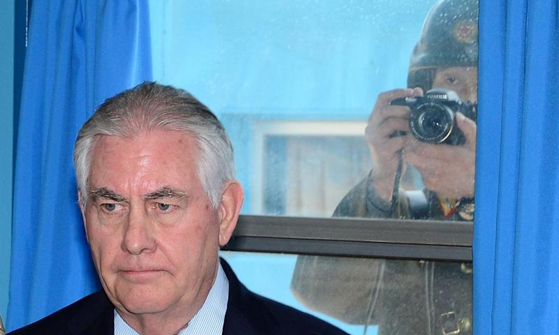 Rex Tillerson is photographed by a North Korean soldier takes a photograph through a window at the border village of Panmunjom, South Korea.