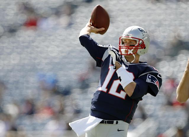New England Patriots quarterback Tom Brady warms up before an NFL football game against the Tampa Bay Buccaneers Sunday, Sept. 22, 2013, in Foxborough, Mass. (AP Photo/Elise Amendola)