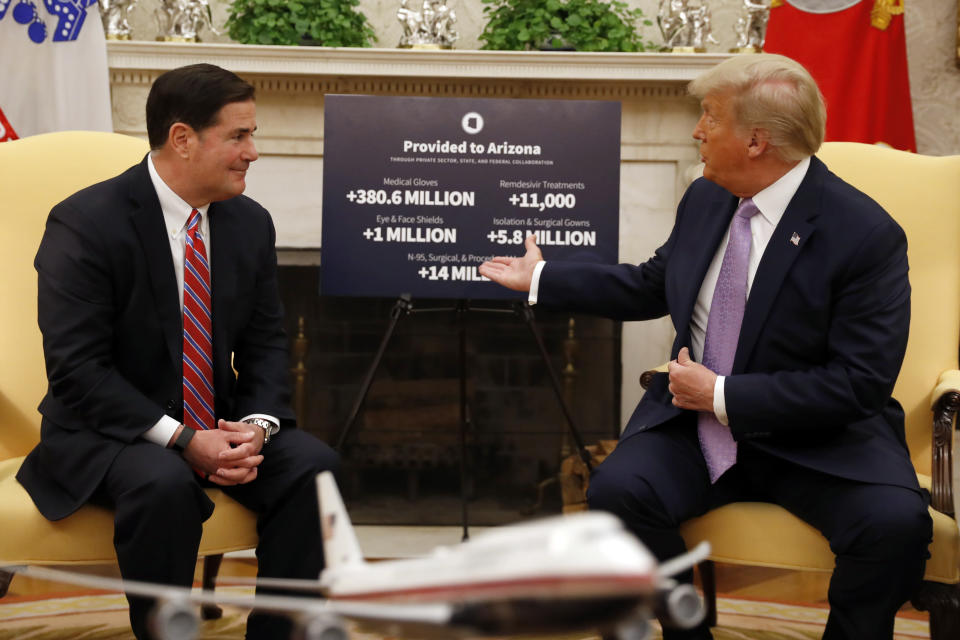 President Donald Trump meets with Arizona Gov. Doug Ducey in the Oval Office of the White House in Washington, Wednesday, Aug. 5, 2020. (AP Photo/Andrew Harnik)