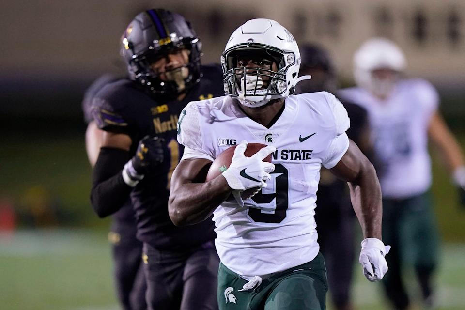 Michigan State running back Kenneth Walker III runs for a touchdown past Northwestern safety Brandon Joseph during the first half on Friday, Sept. 3, 2021, in Evanston, Illinois.