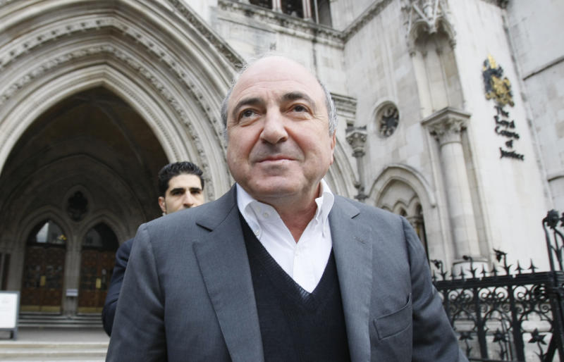 FILE - In this Wednesday, March, 10, 2010 file photo, self-exiled oligarch Boris Berezovsky leaves the High Court in London after winning his libel case against a Russian broadcaster that accused him of masterminding the murder of a former Russian agent in London. Russia's transition from a Kremlin-controlled economy to a free market in the 1990s brought on a wave of contract killings as criminals, entrepreneurs, and corrupt officials tried muscle each other out of lucrative businesses.  The recent death of 67-year old Boris Berezovsky, which remains unexplained, has revived fears that the assassins that have long stalked oligarchs and opposition figures back in Russia have been making their home in the U.K. (AP Photo/Alastair Grant, File)