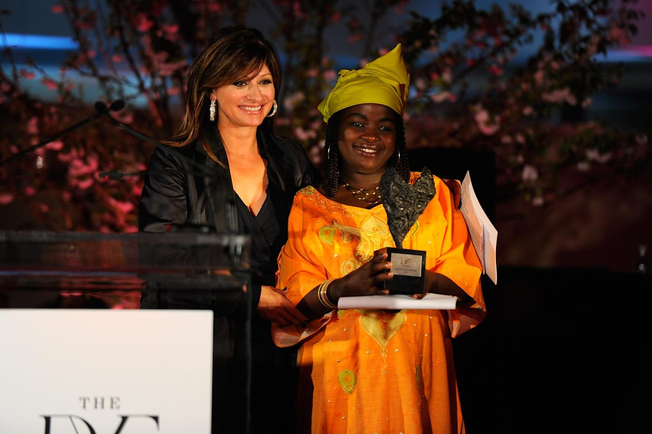 NEW YORK, NY - MARCH 09:  Maria Bartiromo and Chouchou Namegabe pose onstage at the 3rd annual Diane Von Furstenberg awards at the United Nations on March 9, 2012 in New York City.  (Photo by Andrew H. Walker/Getty Images)