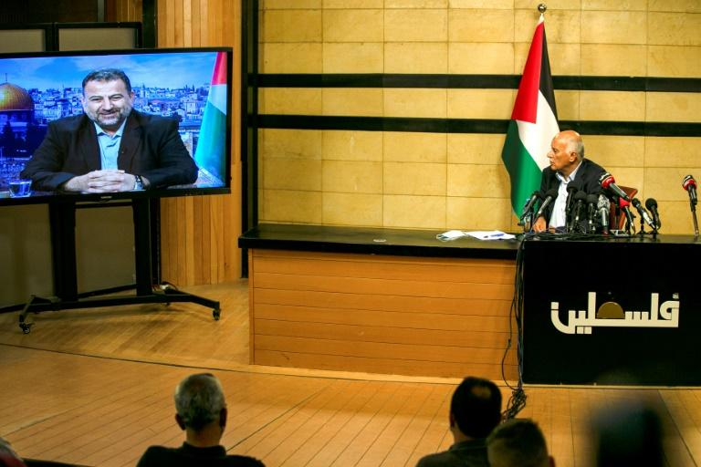 Senior Fatah official Jibril Rajoub, in the West Bank city of Ramallah, attends a rare conference by video-link with deputy Hamas chief Saleh Arouri (on screen from Beirut) to discuss Israel's plan to annex parts of the occupied West Bank