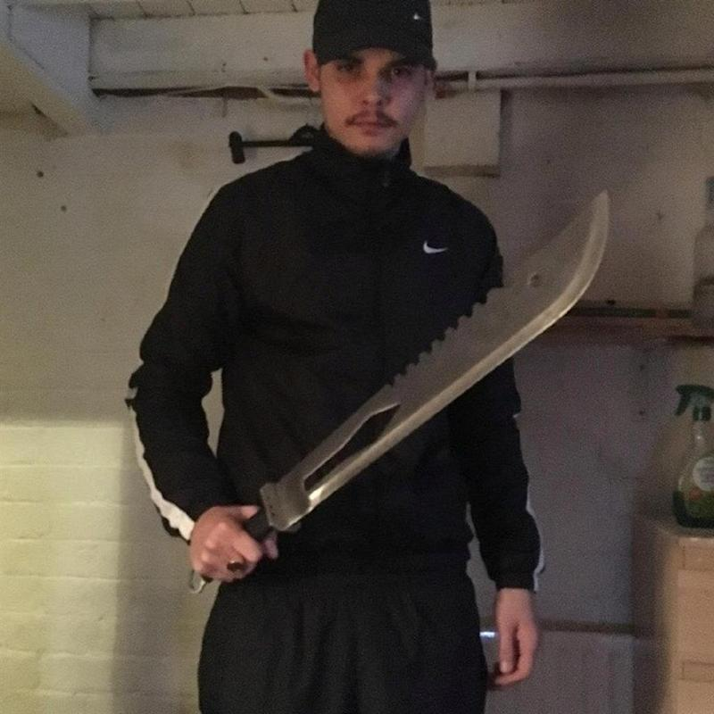 Tommy Lee Jauncey, 23, poses with a 3ft long blade (Picture: SWNS)