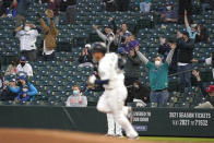 Fans wearing masks as a precaution against COVID-19, cheer as Seattle Mariners' Kyle Seager rounds the bases after hitting a solo home run against the Baltimore Orioles during the fourth inning of a baseball game, Tuesday, May 4, 2021, in Seattle. (AP Photo/Ted S. Warren)