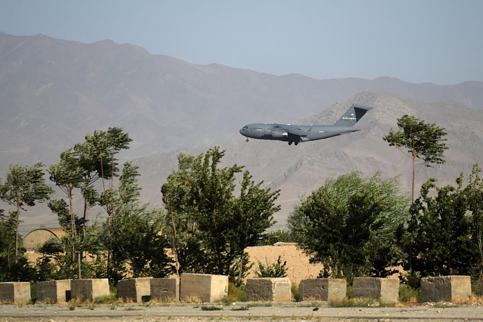 TOPSHOT - A US Air Force transport plane lands at the Bagram Air Base in Bagram on July 1, 2021. (Photo by WAKIL KOHSAR / AFP) (Photo by WAKIL KOHSAR/AFP via Getty Images)