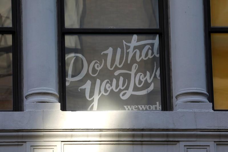 A sign is seen in a window at the WeWork corporate headquarters in Manhattan, New York