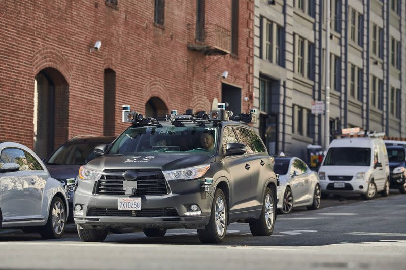 Vehicle belonging to California-based self-driving startup Zoox Inc is seen driving along a street
