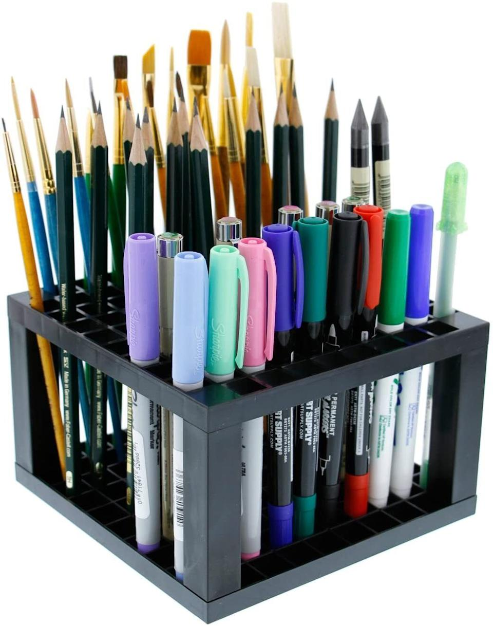 """You can keep up to 96 pens, pencils, markers, brushes and other tiny tools upright and organized.<br /><br /><strong>Promising review:</strong>""""I love everything about this. It's perfect for my desk. I'm an artist, and I bought two for all my markers.<strong>It's lightweight, very classy-looking, and the price is great.</strong>I put one on each end of my desk. They're small but hold so many markers or pencils."""" —<a href=""""https://amzn.to/3mPiOlw"""" target=""""_blank"""" rel=""""nofollow noopener noreferrer"""" data-skimlinks-tracking=""""5902331"""" data-vars-affiliate=""""Amazon"""" data-vars-href=""""https://www.amazon.com/gp/profile/amzn1.account.AFEFKFCO355VDXHABREFA7DEVBIQ?tag=bfmal-20&ascsubtag=5902331%2C26%2C37%2Cmobile_web%2C0%2C0%2C16540740"""" data-vars-keywords=""""cleaning"""" data-vars-link-id=""""16540740"""" data-vars-price="""""""" data-vars-product-id=""""15939477"""" data-vars-retailers=""""Amazon"""">Sherrie Stone</a><br /><br /><strong>Get it from Amazon for<a href=""""https://amzn.to/3uOuFTC"""" target=""""_blank"""" rel=""""nofollow noopener noreferrer"""" data-skimlinks-tracking=""""5902331"""" data-vars-affiliate=""""Amazon"""" data-vars-asin=""""B06Y3P5B5V"""" data-vars-href=""""https://www.amazon.com/dp/B06Y3P5B5V?tag=bfmal-20&ascsubtag=5902331%2C26%2C37%2Cmobile_web%2C0%2C0%2C16540706"""" data-vars-keywords=""""cleaning"""" data-vars-link-id=""""16540706"""" data-vars-price="""""""" data-vars-product-id=""""17884488"""" data-vars-product-img=""""https://m.media-amazon.com/images/I/51S9ffRsVgL.jpg"""" data-vars-product-title=""""U.S. Art Supply 96 Hole Plastic Pencil & Brush Holder - Desk Stand Organizer Holding Rack for Pens, Paint Brushes, Colored Pencils, Markers"""" data-vars-retailers=""""Amazon"""">$7.96+</a>(available in two sizes).</strong>"""