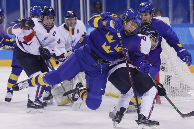 FILE - In this Feb. 20, 2018, file photo, Erika Grahm (24), of Sweden, fights for control of the puck with South Korea's Choi Jiyeon (10), of the combined Koreas team, during the first period of the classification round of the women's hockey game at the 2018 Winter Olympics in Gangneung, South Korea. The leading female hockey players in Sweden were refusing to attend a training camp Thursday, Aug. 15, 2019, or play in an upcoming international tournament in Finland over a pay dispute with the countrys federation. A statement was posted on social media by Sweden player Erika Grahm, saying the action is being taken to develop and create better conditions in the national team to show encouragement and respect for current and future generations.(AP Photo/Frank Franklin II, File)