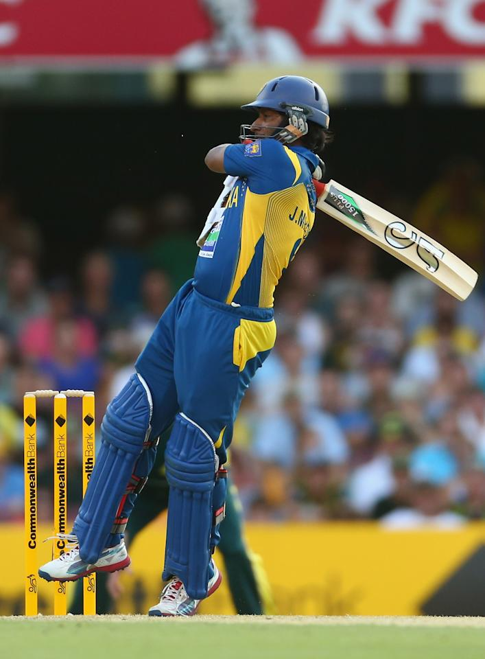 BRISBANE, AUSTRALIA - JANUARY 18: Jeevan Mendis of Sri Lanka hits out during game three of the Commonwealth Bank One Day International Series between Australia and Sri Lanka at The Gabba on January 18, 2013 in Brisbane, Australia.  (Photo by Robert Cianflone/Getty Images)