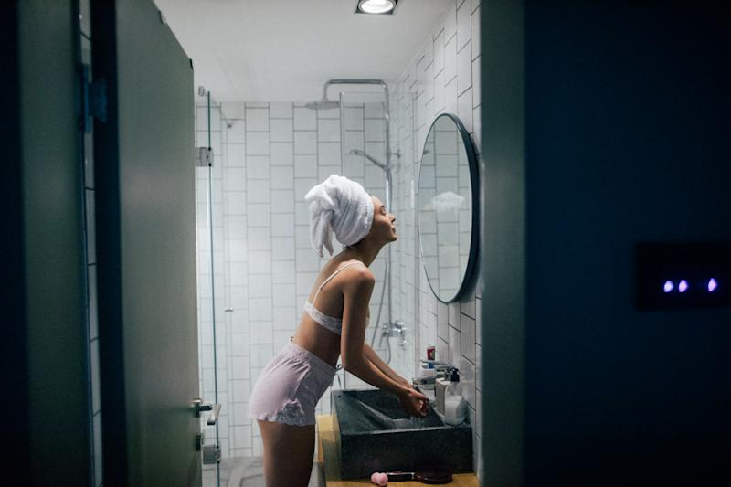 Young woman in the bathroom with her towel on