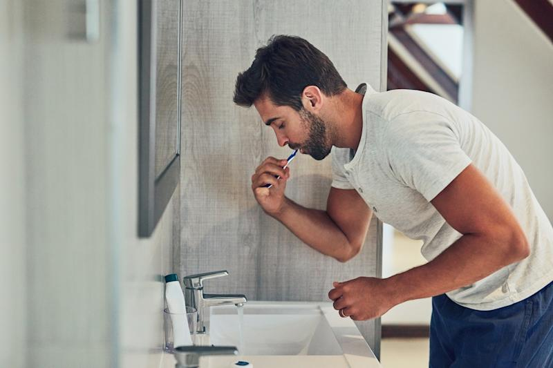 """Researchers say that """"improved oral hygiene care"""" may reduce the risk of heart failure. (Photo: Getty Images)"""