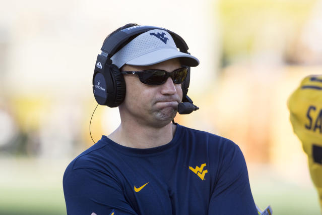 West Virginia head coach Neal Brown watches his team during the first half of an NCAA college football game against Texas, Saturday, Oct. 5, 2019, in Morgantown, W.Va. (AP Photo/Raymond Thompson)